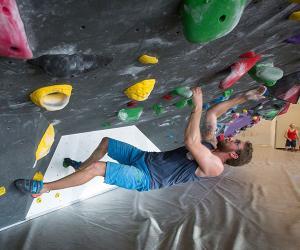 Scott Christenson on indoor climbing wall