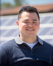 Jason Black in front of solar array